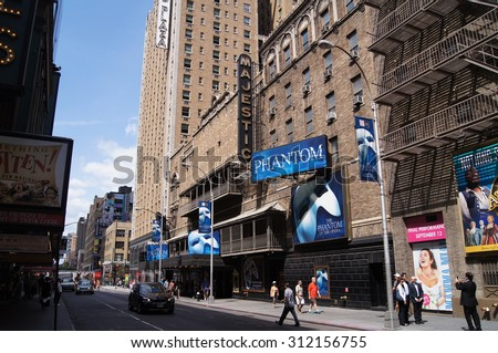 "New York, New York - August 29, 2015 - Broadway's Majestic Theatre, featuring a marquee for the musical ""Phantom of the Opera"" - stock photo"
