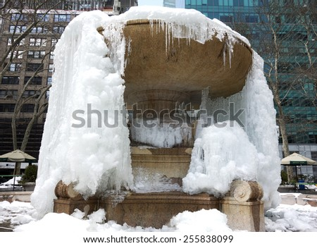 NEW YORK, NEW YORK - February 15, 2015: Fountain in Bryant Park, Manhattan has frozen over due to the below average temperatures. - stock photo