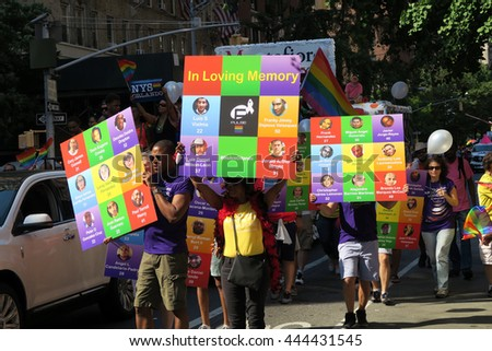 NEW YORK, NEW YORK - JULY 26, 2016: Gay Pride Parade on 5th avenue featuring posters of the 49 people killed on July 12, 2016 in Orlando at the Pulse nightclub . Editorial use only. - stock photo