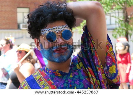 NEW YORK, NEW YORK - JULY 26, 2016: Man with blue glitter beard at Gay Pride Parade on 5th avenue. Editorial use only.