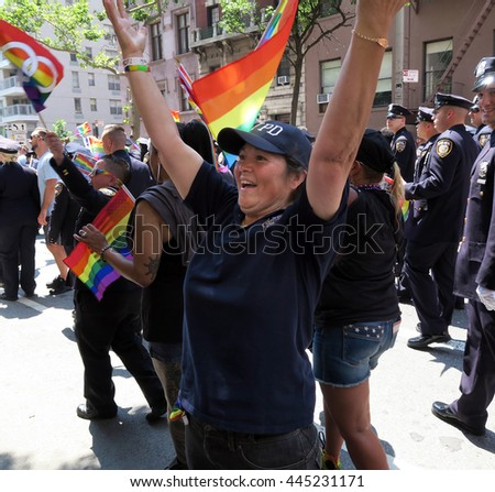 NEW YORK, NEW YORK - JULY 26, 2016: NYPD in Gay Pride Parade on 5th avenue. The rainbow colors are the symbol of lesbian, gay, bisexual and transgender pride and diversity. Editorial use only. - stock photo
