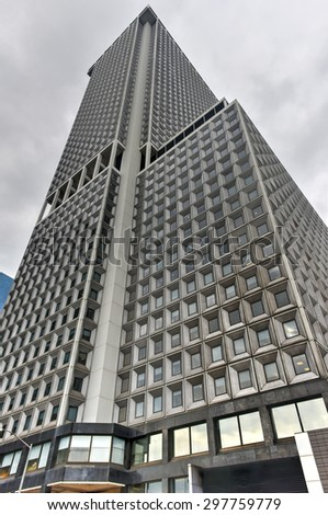 New York, New York - July 15, 2015: One New York Plaza is an office building on the southern tip of Manhattan, built in 1969. The building is 195m tall with 50 floors. - stock photo