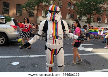 NEW YORK, NEW YORK - JULY 26, 2016: Stormtrooper from Star Wars featuring rainbow colors on his uniform at the Gay Pride Parade on 5th ave. Editorial use only. - stock photo