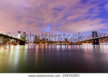 New York, New York - July 4, 2015: View of the Brooklyn Bridge and Manhattan Bridge at sunset from Brooklyn Bridge Park, New York. - stock photo