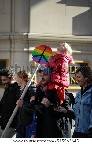 "New York, New York. - November 12, 2016: Parents and child marching at a ""Trump is not my President"" rally against President elect Donald Trump in Manhattan in 2016 in New York City."