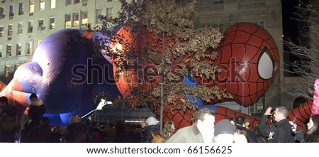 NEW YORK, NEW YORK - NOVEMBER 24: Spiderman balloon gets inflated the night before the Macy's Thanksgiving parade. Taken November 24, 2010 in New York City. - stock photo