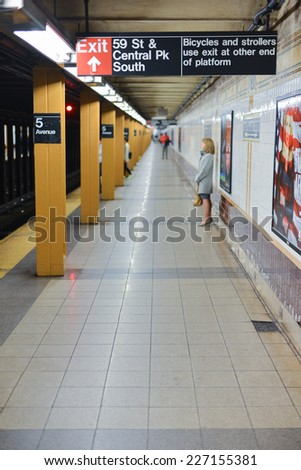 NEW YORK, NEW YORK - OCTOBER 27, 2014: Fifth Avenue Subway Station, New York as the R train passes by. - stock photo