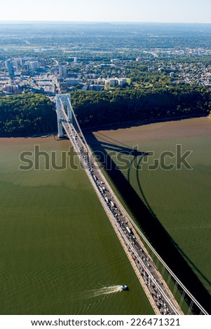 NEW YORK, NEW YORK - SEPTEMBER 27, 2014: Stunning aerial view of the George Washington Bridge from a helicopter. - stock photo