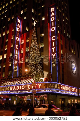 New York, New York, USA - December 19, 2005: An exterior evening shot of Radio City Music Hall during the Christmas season in New York City. People can be seen on the street and on the sidewalk. - stock photo