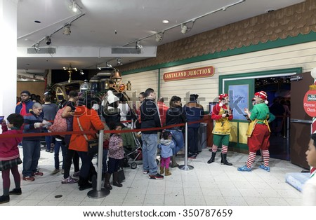 NEW YORK, NEW YORK, USA - DECEMBER 10: People wait on line to see Santa in Macy's Herald Square and 34th street. Taken December 10, 2015 in NY. - stock photo
