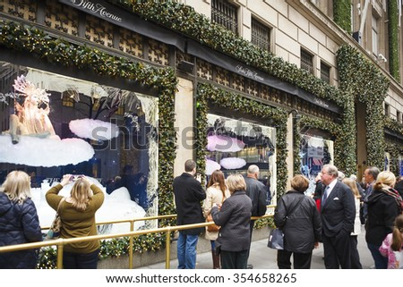New York, New York, USA - December 11, 2015: The flagship store of the luxury department store chain Saks Fifth Avenue on 5th Avenue in Manhattan during the Christmas Holiday season. - stock photo