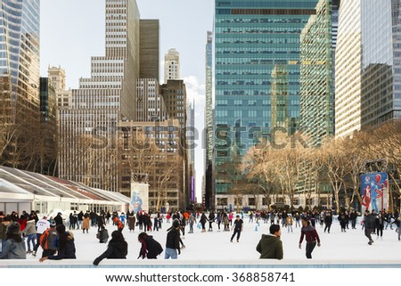 New York, New York, USA - January 27, 2016: People ice skating at Bryant Park's winter skating rink.
