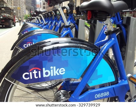 New York, New York, USA - June 6, 2013: Citi Bike rental bicycles locked in a rental station on Broadway in Midtown Manhattan. These rental bicycle stations are in various New York City locations.