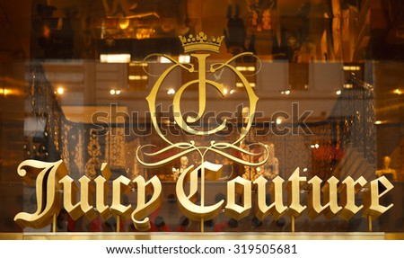 New York, New York, USA - March 14, 2011: The Juicy Couture logo display above the entrance to the Juicy Couture store on Fifth Avenue in New York City. Juicy Couture produces women's clothing etc. - stock photo