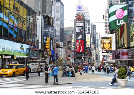 New York, New York, USA - May 1, 2011: Times Square on a bright afternoon photographed from 44th street looking uptown or north.  - stock photo