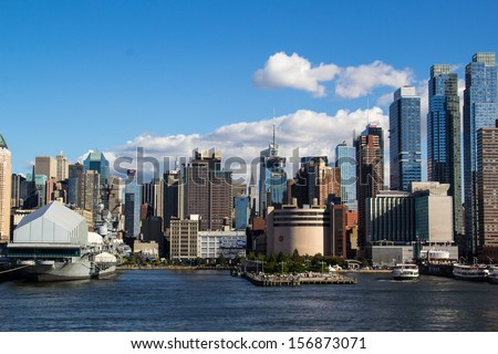 NEW YORK, NEW YORK, USA-SEPTEMBER 28: Manhattan buildings reflect the setting sun on September 28, 2013. New York is the largest city in the USA and has millions of yearly visitors.