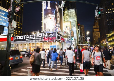 New York, New York, USA - September 14, 2012: People crossing 7th Avenue at 34th Street in Midtown Manhattan in the early evening. - stock photo