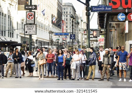 New York, New York, USA - September 23, 2015: People waiting to cross Seventh Ave. at 34th St. in Manhattan.