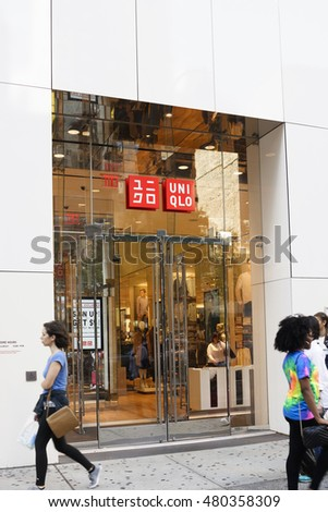 New York, New York, USA - September 7, 2016: People walk by Uniqlo store on 34th Street. Uniqlo is a Japanese provider of casual clothing.