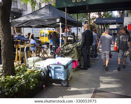 New York, New York, USA - September 19, 2013: TV show personnel monitor an indoor shoot at the Gotham Bar and Grill in Manhattan for the CBS crime drama Blue Bloods. Pedestrians can also be seen. - stock photo