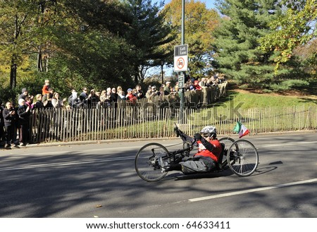 NEW YORK - NOV. 7:  An unidentified hand cyclist (wheeler) with a prosthetic leg cycles the last few miles of the 2010 New York City Marathon in Central Park on Nov. 7, 2010 in New York, NY - stock photo