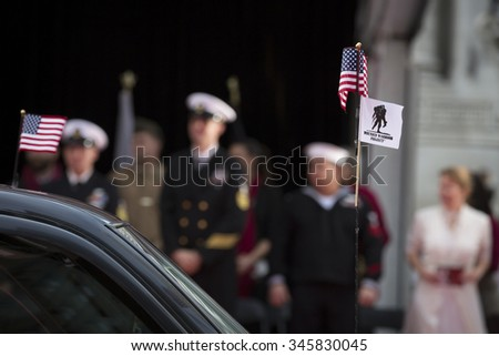 NEW YORK - NOV 25 2015: Close up of the American Flag and Wounded Warrior Project Flag attached to the antenna of a parade vehicle during the Americas Parade up 5th Avenue on Veterans Day in New York. - stock photo