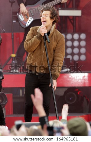 NEW YORK - NOV 26: Harry Styles of One Direction performs on 'Good Morning America' in Central Park on November 26, 2013 in New York City. - stock photo