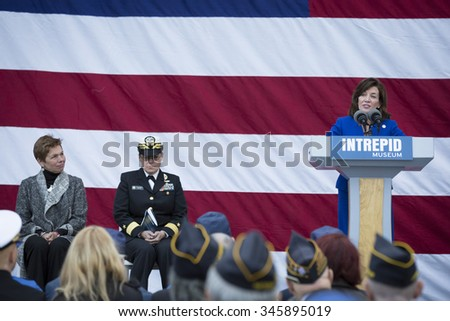 NEW YORK - NOV 25 2015: Kathleen Hochul, Lt Governor, State of New York speaks to the audience at the Intrepid Sea, Air & Space Museum wreath laying ceremony at Pier 86 on Veterans Day in Manhattan. - stock photo