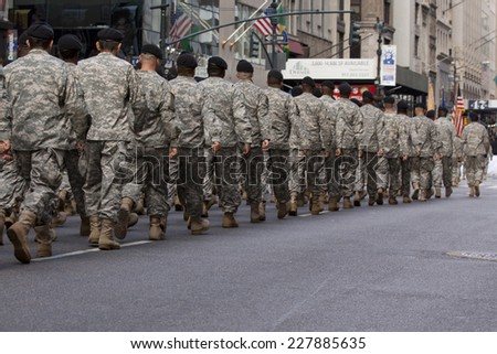 NEW YORK - NOV 11, 2013: Members of the US Army wearing ACU's march during the 2013 America's Parade held on Veterans Day in New York City on November 11, 2013. - stock photo
