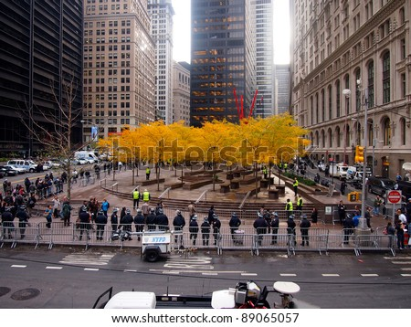 NEW YORK - NOV 15: Police guard an empty Zuccotti Park, Lower Manhattan, on November 15, 2011 in New York City. Occupy Wall Street protesters had been removed from the park early in the morning. - stock photo