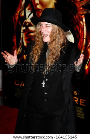 """NEW YORK-NOV 20; Singer songwriter Patti Smith attends """"The Hunger Games: Catching Fire"""" special screening at AMC Lincoln Square Theater on November 20, 2013 in New York City. - stock photo"""