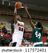 NEW YORK-NOV 3: St. John's Red Storm guard Shenneika Smith (35) shoots over Farmingdale Rams center Wabiyn Ati at Carnesecca Arena on November 3, 2012 in Jamaica, Queens, New York York. - stock photo