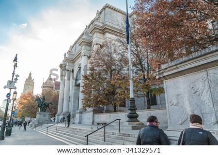 NEW YORK - NOV 17, 2015: the front entrance steps of the American Museum of Natural History in fall with colorful changing leaves in Manhattan NY. AMNH is a famous museum in Manhattan, NYC, USA. - stock photo