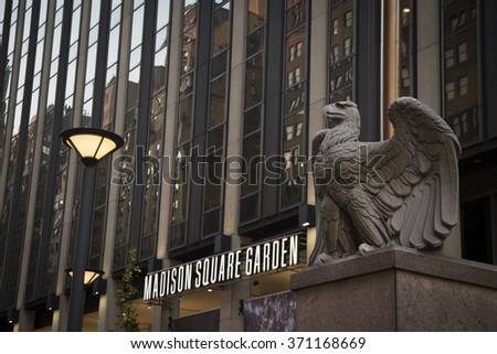 NEW YORK - NOV 25 2015: The large stone eagle sculpture outside the 7th Avenue entrance to Madison Square Garden sports arena in Manhattan. NY Penn Station is located underneath the arena. - stock photo