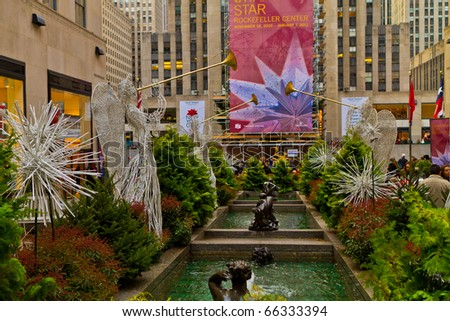 NEW YORK - NOV 27: The Rockefeller center started to show his annual famous Christmas decoration displays, people enjoy the ice skating rink and buy Christmas gifts, on November 27, 2010, in New York. - stock photo