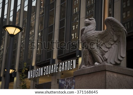NEW YORK - NOV 25 2015: The 7th Avenue entrance to Madison Square Garden sports arena in Manhattan, with the large stone eagle sculpture in foreground. NY Penn Station is located underneath the arena. - stock photo