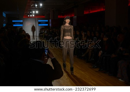 NEW YORK - NOVEMBER 19: A Model walks runway for Anntarah presentation at Metropolitan Pavilion 125W 18th Street during Peru Expo on November 19, 2014 in NYC.