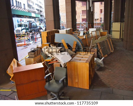 NEW YORK, NOVEMBER 3: A pile of waterlogged office furniture sits on a sidewalk in New York City, November 3, 2012. Lower Manhattan was seriously damaged by flooding from Hurricane Sandy. - stock photo