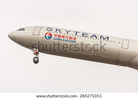 NEW YORK - NOVEMBER 3: Airbus A340 China Eastern Airlines painted in the SkyTeam livery takes off from JFK in New York, USA on November 3, 2013. China Eastern Airlines is a major Chinese airline. - stock photo