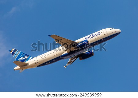 NEW YORK - NOVEMBER 3: Airbus A320 JetBlue arrives at JFK Airport in New York, NY on November 3, 2013. A320 was the first narrow body airliner from Airbus. It is the biggest competition to Boeing 737. - stock photo