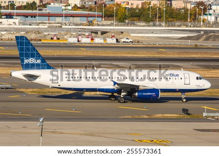 NEW YORK - NOVEMBER 3: Airbus A320 JetBlue taxis at JFK Airport in New York, NY on November 3, 2013. A320 was the first narrow body airliner from Airbus. It is the biggest competition to Boeing 737. - stock photo