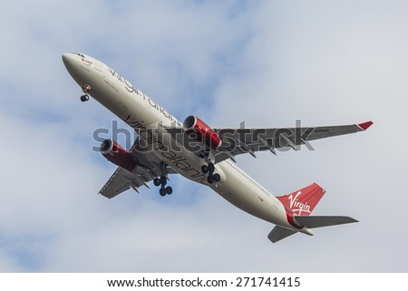 NEW YORK - NOVEMBER 3: Airbus 330 Virgin Atlantic lands at JFK in New York, NY on November 3, 2013. Virgin Atlantic is British airline owned by Richard Branson's Virgin Group and Singapore Airlines. - stock photo