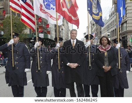 NEW YORK - NOVEMBER 11: Bill de Blasio & Letitia James march with police officers of Port Authority at the 94th annual New York City Veterans Day Parade on 5th Avenue on November 11, 2013 in New York