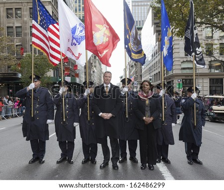 NEW YORK - NOVEMBER 11: Bill de Blasio & Letitia James march with police officers of Port Authority at the 94th annual New York City Veterans Day Parade on 5th Avenue on November 11, 2013 in New York - stock photo