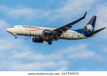 NEW YORK - NOVEMBER 3: Boeing 737 Aeromexico approaches JFK in New York, USA on November 3, 2013. Aeromexico is the flag carrier airline of Mexico and the biggest Mexican Airline. - stock photo
