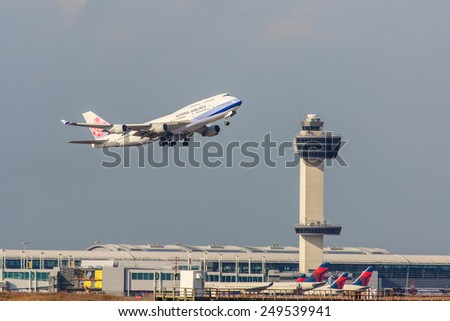 NEW YORK - NOVEMBER 3: Boeing 747 China Airlines takes off from JFK Airport in New York, USA on November 3, 2013. China Airlines is the flag carrier of the Republic of China, commonly known as Taiwan. - stock photo