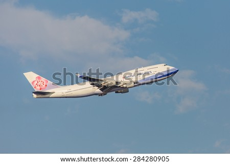 NEW YORK - NOVEMBER 2: Boeing 747 China Airlines takes off from JFK Airport in New York, USA on November 2, 2013. China Airlines is the flag carrier of the Republic of China, commonly known as Taiwan. - stock photo
