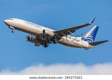 NEW YORK - NOVEMBER 3: Boeing 737 Copa Airlines takes off from JFK International Airport in New York, NY on November 3, 2013. Boeing 737 is the best-selling commercial jetliner of all times. - stock photo