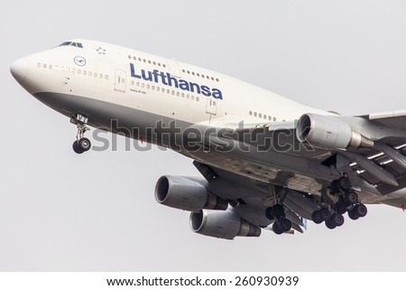 NEW YORK - NOVEMBER 4: Boeing 747 Lufthansa approaches JFK Airport located in New York, USA on November 4, 2013. Lufthansa is the flag carrier of Germany and the largest airline in Europe. - stock photo
