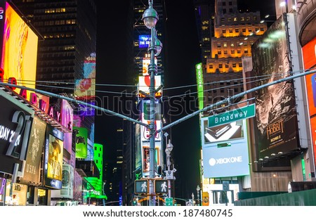 NEW YORK - NOVEMBER 22, 2013:  Broadway signboard by night,Manhattan.Brodadway is one of the world's busiest pedestrian intersections and a major center of the world's entertainment industry. - stock photo